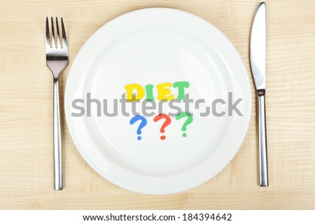 Plate with inscription diet on wooden table close-up - stock photo
