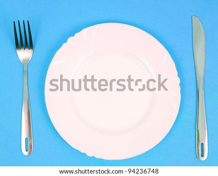 plate with knife and fork - stock photo