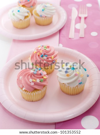 Plate with pink cupcakes - stock photo