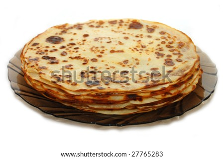 Plate with Russian pancakes on a white background
