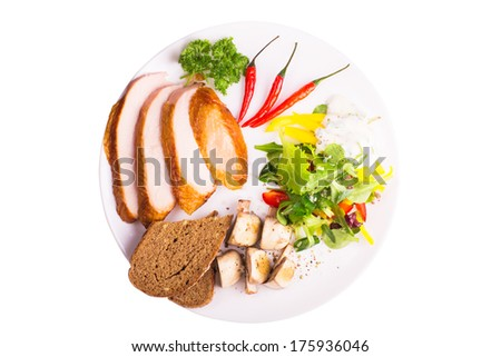 Plate with salad, fried mushrooms, chili pepper, bread and turkey - stock photo