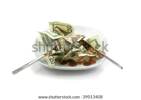 Plate with salad made of money and coins - stock photo