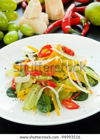 Plate with salad of mixed veggies and fruits. Shallow dof.