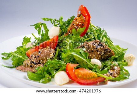 plate with salad on a white background for the menu