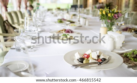 plate with salad placed on a table in a restaurant