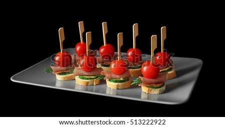 Plate set delicious canapes on black stock photo 546713014 for Canape bread mold set