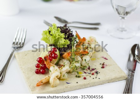 Plate with shrimps in restaurant