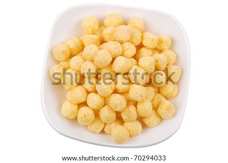 Plate with sweet cornflakes on white background - stock photo