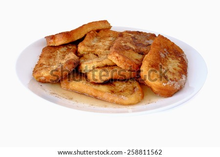 Plate with torrijas, typical spanish dessert for Lent and Easter