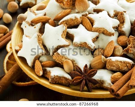 Plate with traditional christmas cinnamon cookies Zimtsterne. Shallow dof. - stock photo