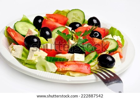 Plate with vegetable salad on background