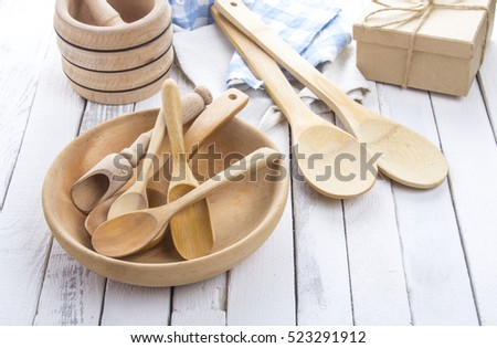 plate wooden spoons kitchen table rustic wooden background