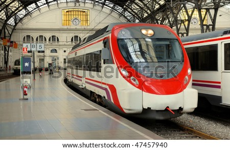 platform and cars at the french station in barcelona, spain - stock photo
