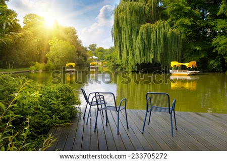 platform beside lake in park - stock photo