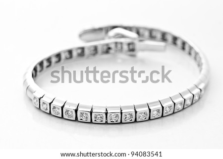 platinum lace decorated with diamonds on white background - stock photo