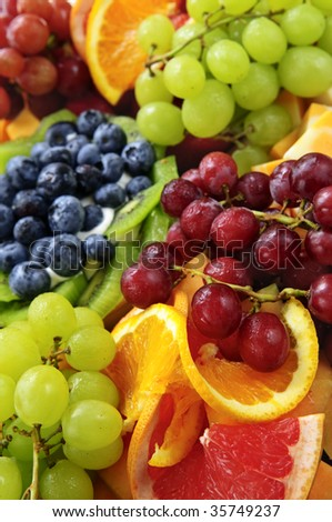 Platter of assorted fresh fruit and cheese - stock photo