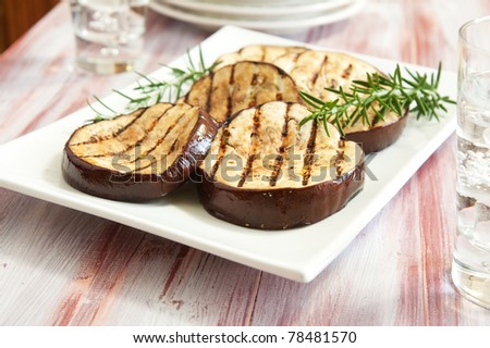 Platter of grilled eggplant with rosemary