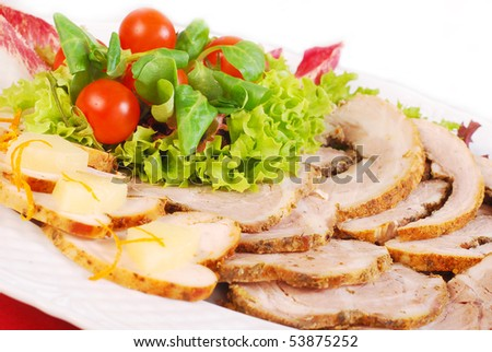 platter of various  roasted meat slices with lettuce and tomato  decoration - stock photo