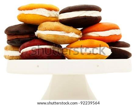 Platter Stacked With A Variety Of Whoopie Pies Isolated On White Background - stock photo
