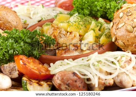 Platter with meat, vegetables and bread