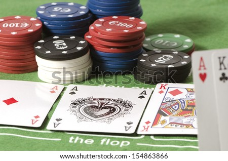 Play of Texas Hold 'em Poker with ase and king in the flop and in the hand, full. - stock photo
