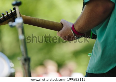 play on guitar, selective focus  - stock photo