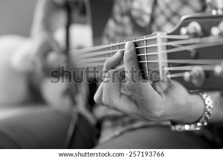 play the guitar monochrome black and white - stock photo