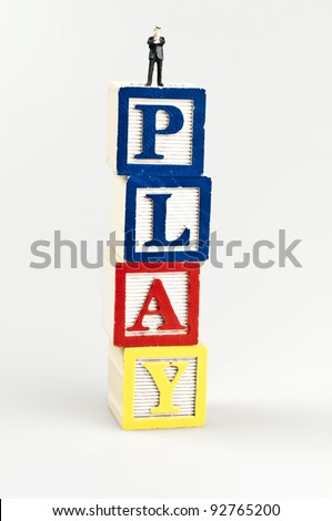 Play word and toy business man - stock photo