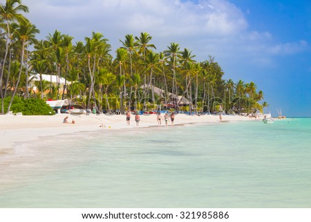 Playa Bavaro, Dominican Republic- April 28, 2015: Crystal clear water on the beach near touristic resort in the high noon - stock photo