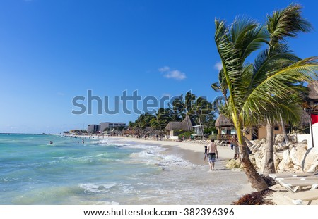 Playa del Carmen, Mexico - January 5 2016 - People on the beach in Playa del Carmen. The city boasts a wide array of tourist activities due to its geographical location in the Riviera Maya. - stock photo