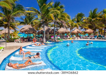 PLAYA DEL CARMEN, MEXICO - JULY 20, 2011: Scenery of luxury swimming pool at RIU Yucatan Hotel in Playa del Carmen. RIU Hotels & Resorts has more than 100 hotels in 19 countries. - stock photo