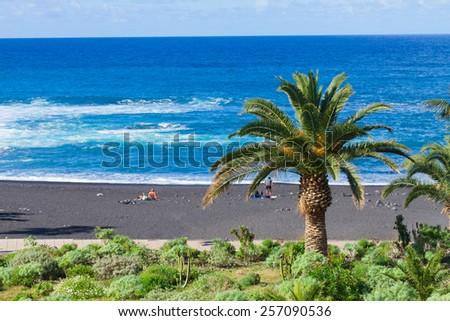 playa Jardin - beach with black volcanic sand, Puerto de la Cruz, Tenerife island, Spain - stock photo