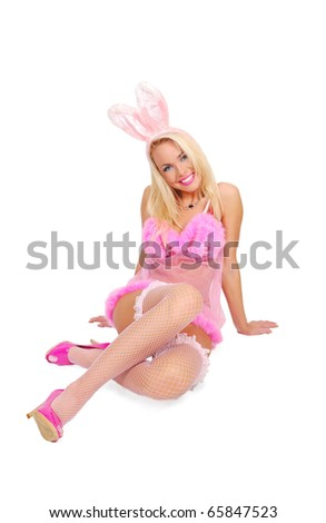 Playboy girl in a rose baby-doll and rabbit ears - stock photo
