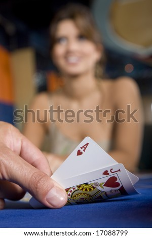 Player hand revealing Blackjack - Ace and jack - stock photo