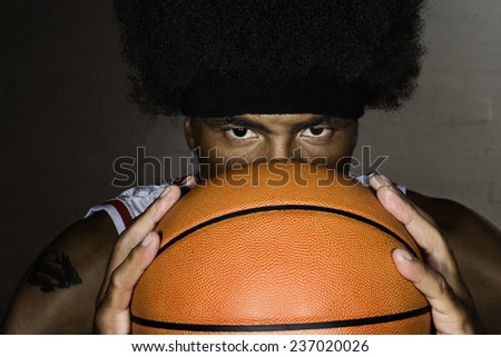 Player Holding Basketball - stock photo
