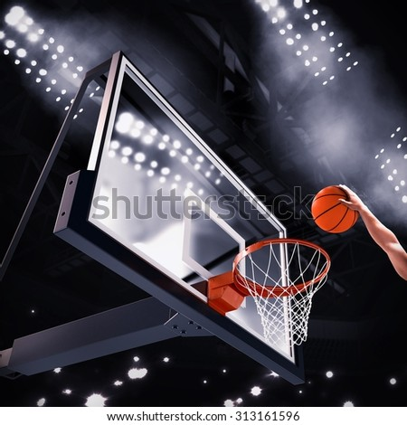 Player throws the ball in the basket - stock photo