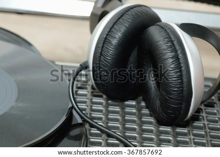 player with headphones on vinyl plates