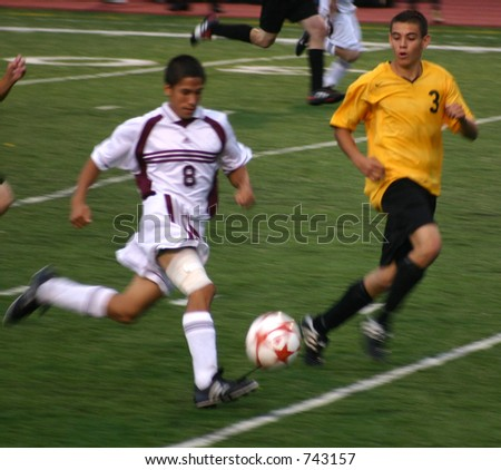 Players run the ball down field.  (Editorial Use Only) - stock photo