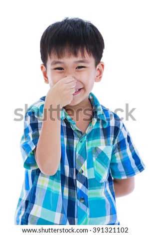 Playful asian boy covering his nose. Isolated on white background. Positive human emotion, facial expression feeling reaction. Studio shot. - stock photo