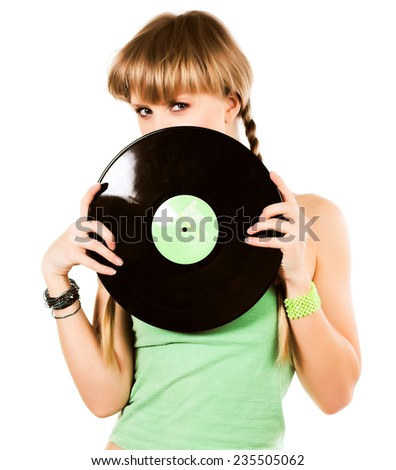 playful blond girl with vinyl records over white