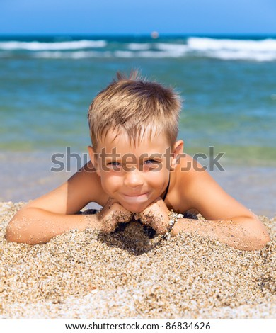playful boy on the beach