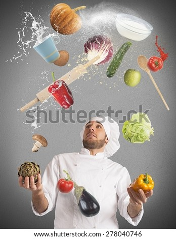 Playful chef likes to juggle while cooking - stock photo