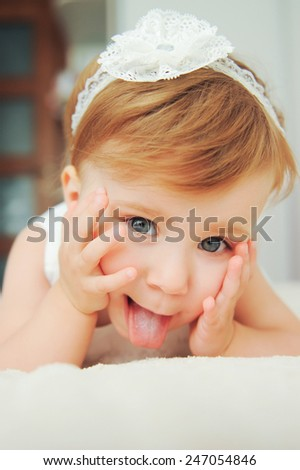 playful child with lace headband - stock photo