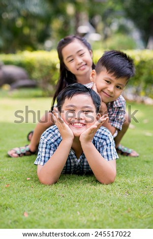 Playful children lying on the grass in the park