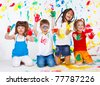 Playful children painted all over - stock photo
