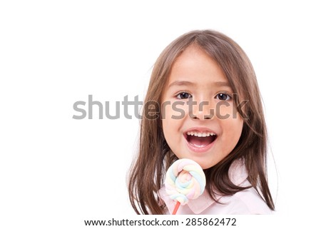 playful cute little girl with sweet colorful marshmallow - stock photo