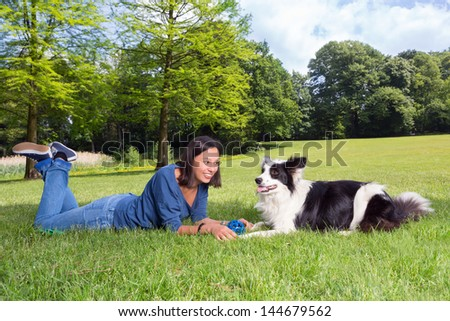 Playful dog waiting for his boss to throw the ball - stock photo