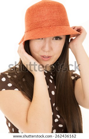 Playful expression teen model wearing orange hat - stock photo