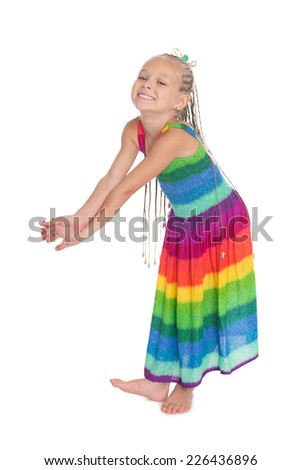 Playful girl in a bright coloreddress in full growth. The girl is six years old. - stock photo