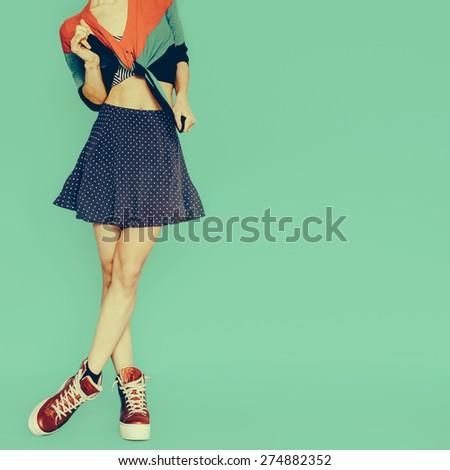 Playful Girl in skirt polka dot on blue background. Vintage style - stock photo